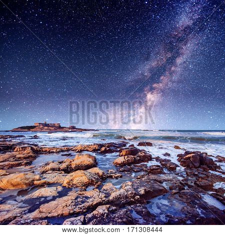 Fantastic views of the starry sky reserve of Monte Cofano. The dramatic scene. Sunset over the sea. Location Cape San Vito. Sicily, Italy, Europe. Mediterranean and Tyrrhenian Sea.