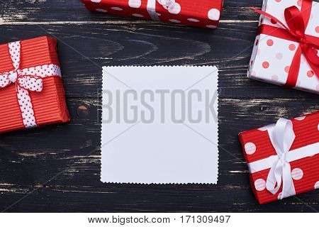 Top view of a batch of gift boxes with a place for copy space in the center. Square copy space surrounded by present boxes