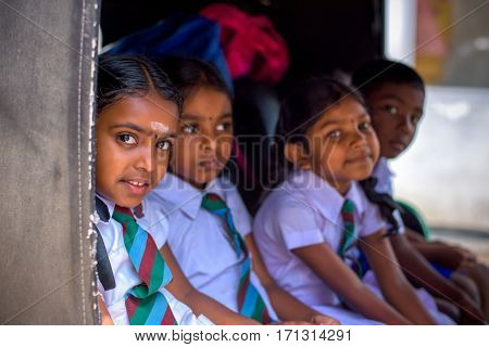 KANDY SRI LANKA - MARCH 17 2016: Children smiling on the car before go to school and looking at camera on March 17 2016 in Kandy Sri Lanka.