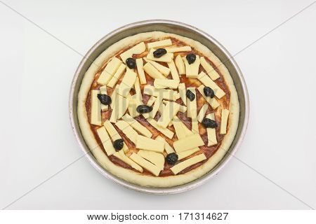 pizza dough tomato paste and cheese on tray with isolated white background