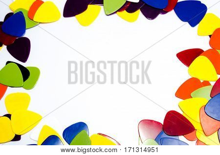 Pick guitar ,Plectrum music colorful background and frame