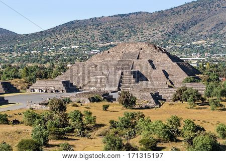 Pyramid of the Moon with Plaza of the Moon and a part of the Avenue of the Dead seen from the Pyramid of the Sun in San Joan Teotihuacan near Mexico City Mexico on a sunny afternood.
