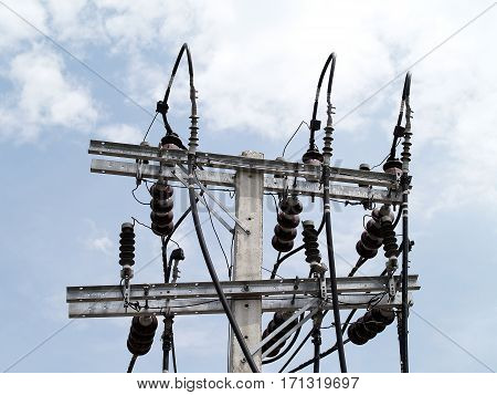 electric high voltage power pole connected to high-voltage lines with blue sky background