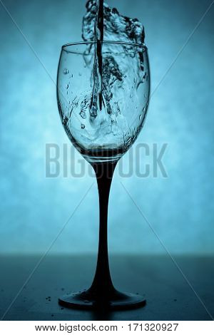 liquid in a glass of wine backlit