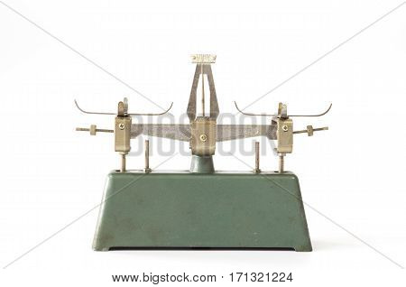 Old vintage metal antique balance scale on white background