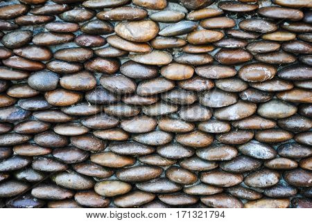 background of small gravel stone texture.Sea stones wall abstract background.
