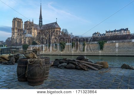 Docks of Notre Dame Cathedral in Paris with old barrels, France