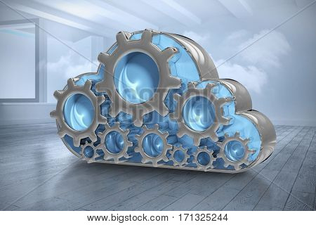 Digitally generated image of gear in cloud shape against room with holographic cloud 3d