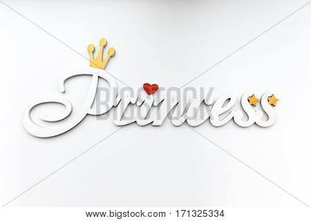 White inscription Princess. Decorative letters forming word Princess on white background.