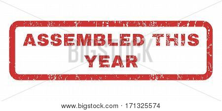Assembled This Year text rubber seal stamp watermark. Caption inside rectangular shape with grunge design and unclean texture. Horizontal vector red ink sticker on a white background.