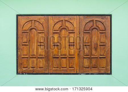 Old Teak Wood Window On Green Wall