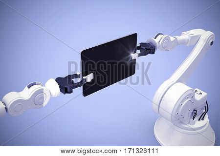 Digital generated image of robots holding computer tablet against purple background 3d