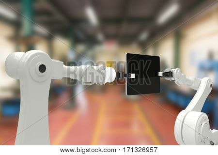 Digital composite image of robots and digital tablet against workshop 3d