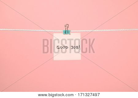 """Pink Paper Sheet On The String With Text """"good Job"""""""