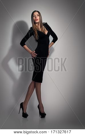 Vogue style photo of pretty young model in black dress