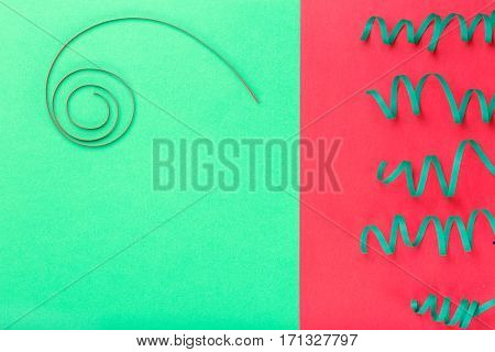 Colorful celebration background with streamers top view.