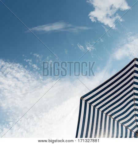 Beach umbrella on a sunny day with blue sky