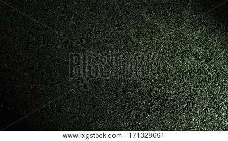 Asphalt, asphalt texture, asphalt background, scabrous asphalt. Grunge background. Green asphalt. Green background.