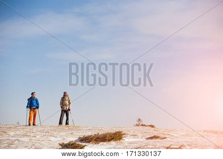 A Group Of Climbers In The Mountains.