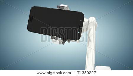 Digital generated image of robot holding smart phone against grey vignette 3d