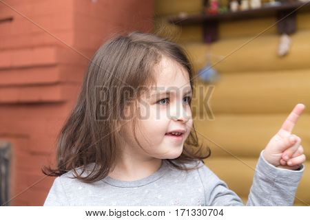 portrait of a little girl shows the direction
