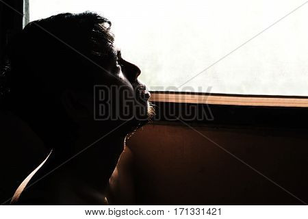 Depressed And Hopeless Man Alone In The Room With Window