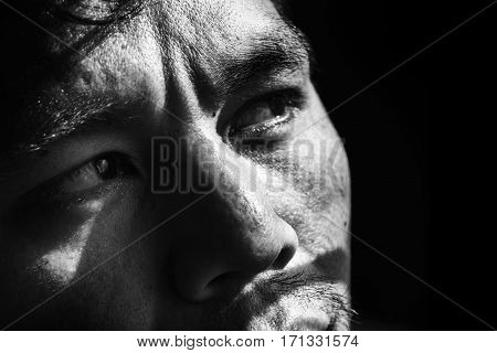 Face Of Depressed And Hopeless Man On Black