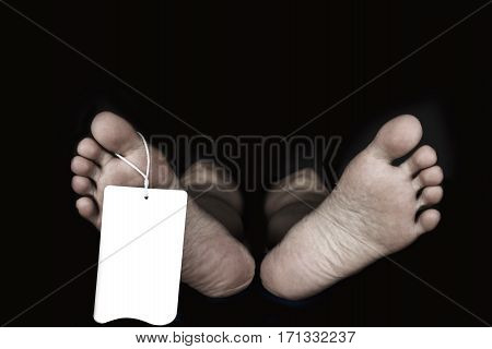 Bare Feet Of Woman With Label On It