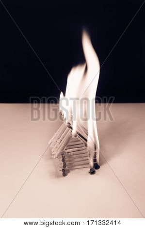 Burning matches house - dangerous games with fire ends with accident black and white
