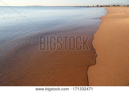 calm transparent sea and the sandy beach at sunrise, Red Sea, Egypt