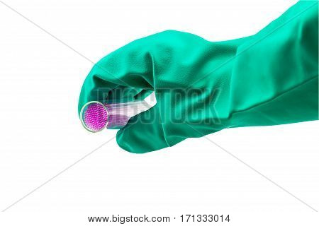 Capillary tube on hand of scientist with blue glove on white .Saved with clipping path selective focus.