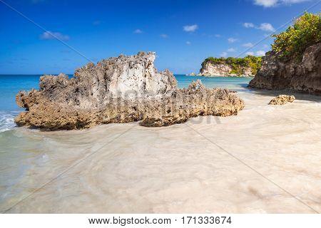 Coastal Rocks And Sand Of Macao Beach