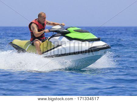 Young man having fun on a jet ski