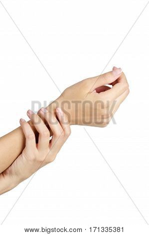 Woman holding her wrist in pain isolate on white background.