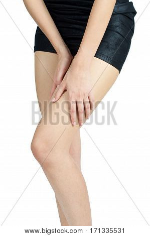 Woman holding her thigh in pain area isolate on white background.