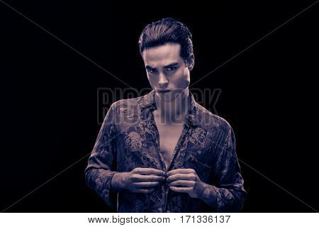 Handsome Man Model Looking At Camera, Buttoning Shirt