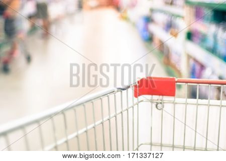 Supermarket Store Blurred Background With Close Up Shopping Cart And Bokeh Light