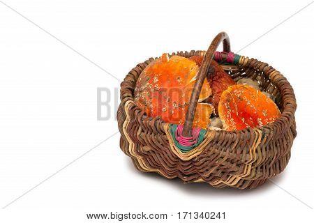 Basket with Amanita muscaria mushrooms. Orange toadstools. Isolated poison.