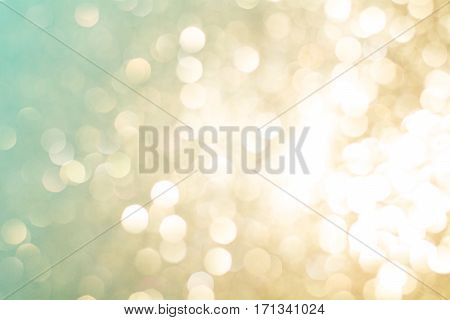 Festive abstract background with bokeh lights. Gold and green boke texture of Christmas Light.