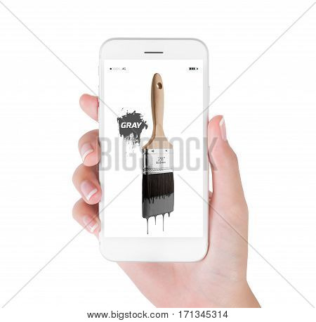 Woman using smart phone searching paintbrush loaded gray color dripping off bristles. Art and Design concept isolated white background.