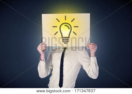 Young businessman hiding behind a lightbulb drawn on paper