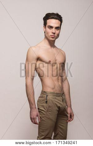 Young Man Model Shirtless Body Posing Pants