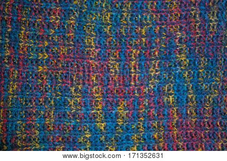 Knitted fabric texture. Closeup view of multicolored fabric jersey. Multicolor abstract background and texture for designers. Colorful cloth background.
