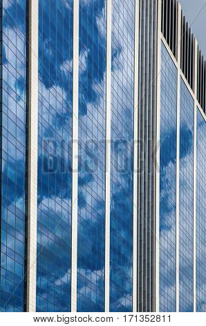 Glass skyscraper against blue sky