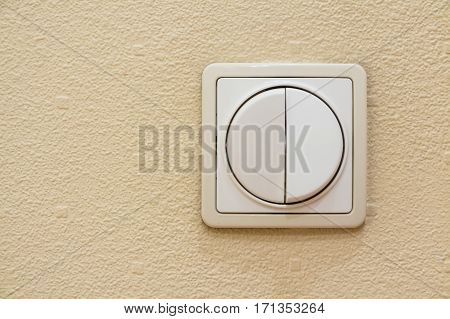 Two keys beige light switch mounted on wall