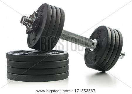 The metal dumbbell and weights isolated on white background.