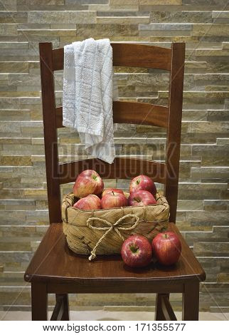 Vintage chair with a basket of apples