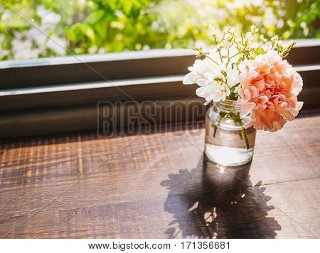 Flowers carnation decoration glass on wooden table Hipster decoration Vintage style