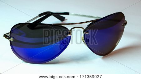 Beautiful ultraviolet sunglasses aviator isolated on white background