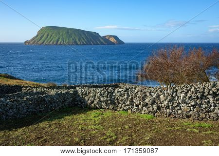 South of Terceira island with goat islands in Azores Portugal and typical stone fences